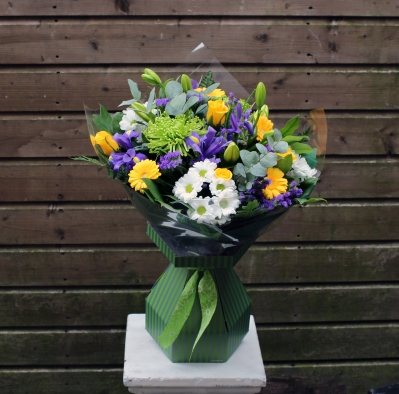 Yellow, Purple and Green hand tied.